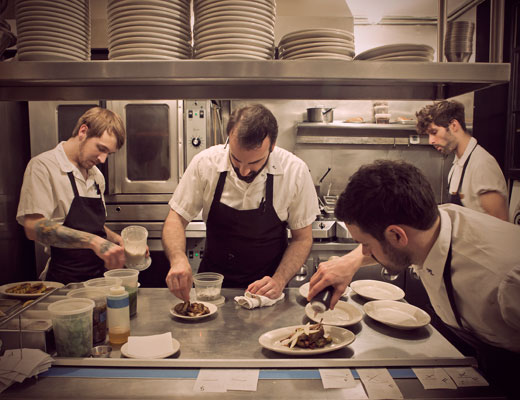 Chefs prepare dishes in Rucola's kitchen